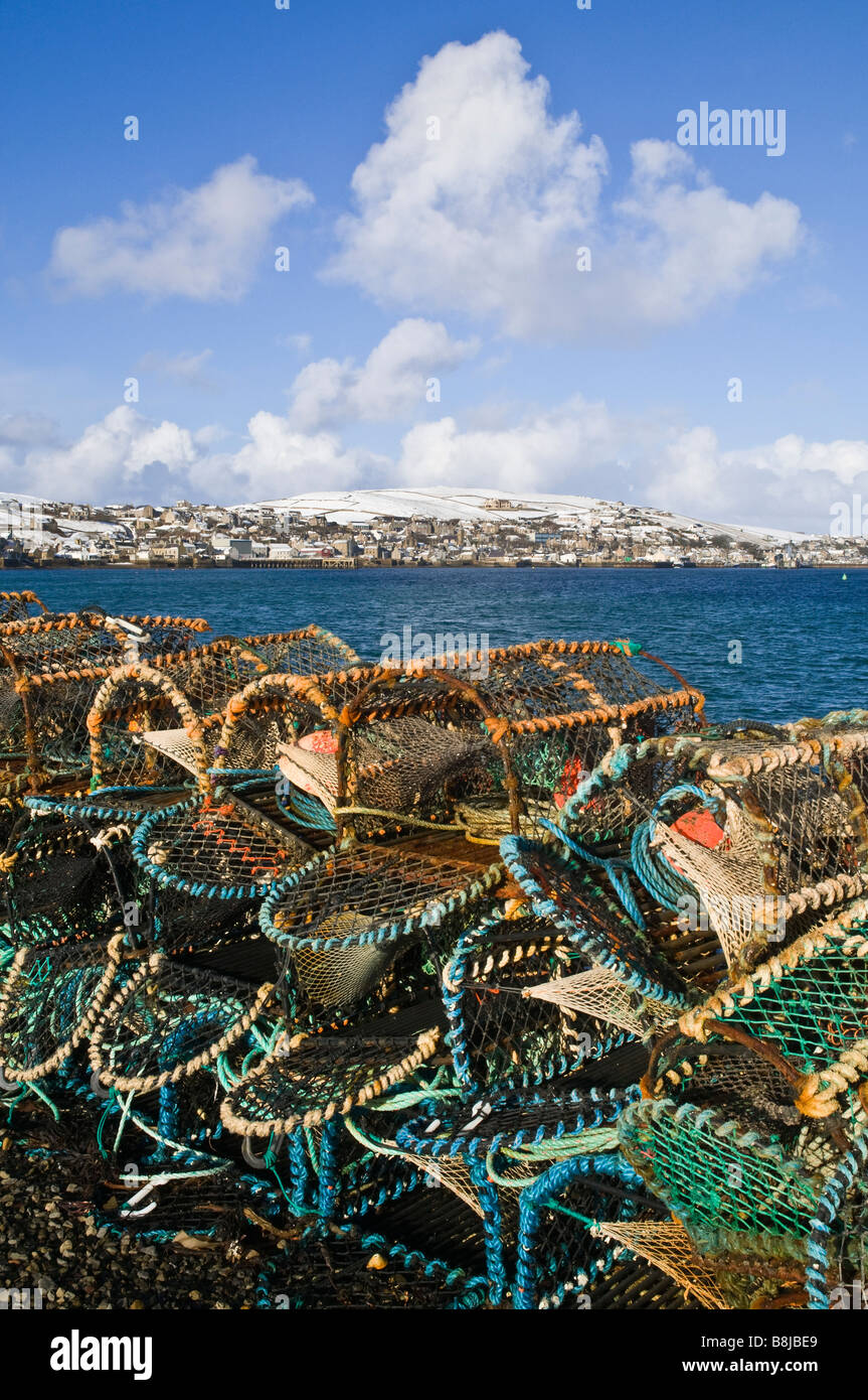 dh  STROMNESS ORKNEY Crab and lobster creels Hamnavoe harbour snow hills lobsterpots baskets Stock Photo