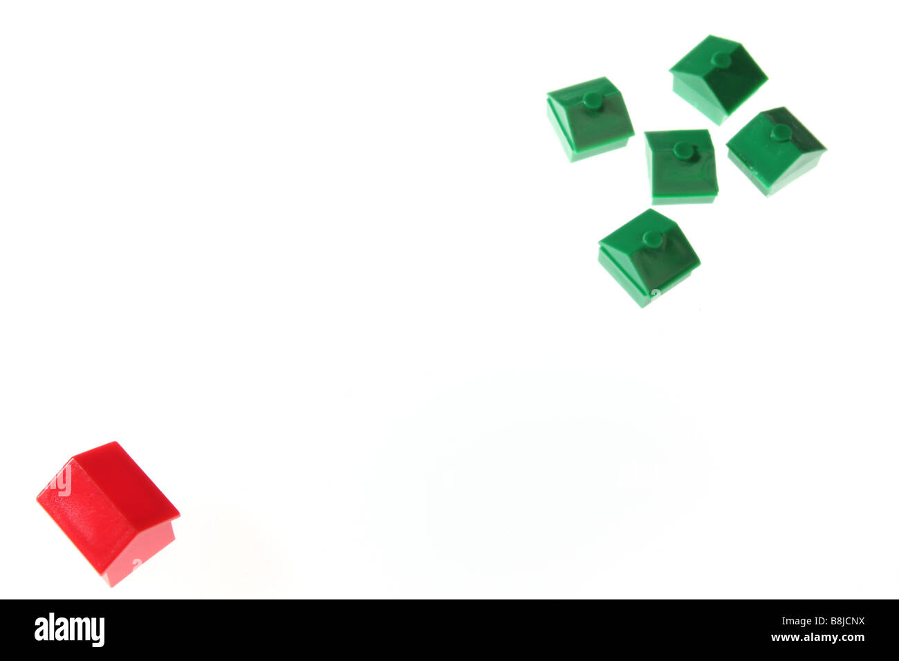 Monopoly houses shot against a white background - Stock Image