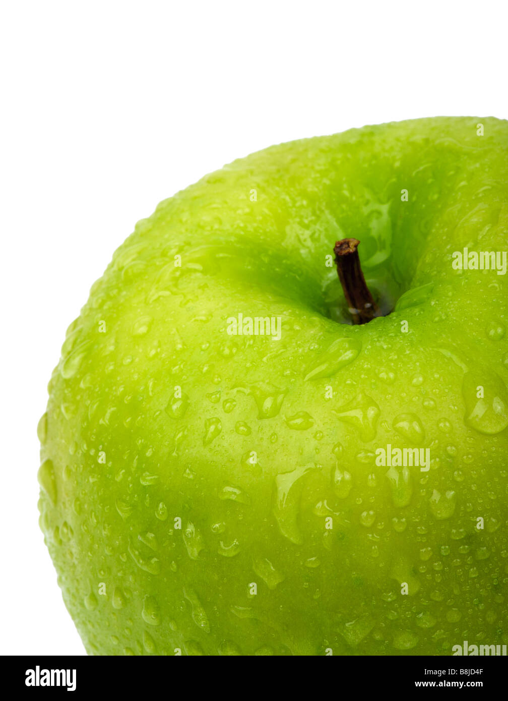 Green apple with water drops. Close-up - Stock Image