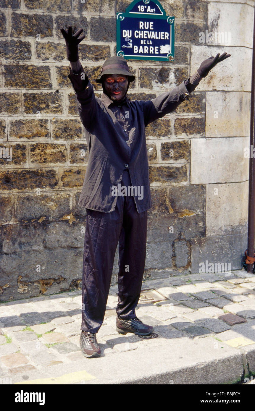 Montmartre Mime artist Dressed as chimney sweep Black face PARIS FRANCE - Stock Image