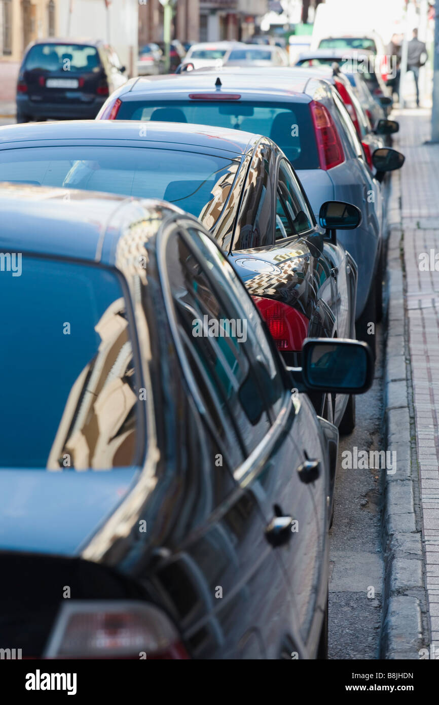 Row of parked cars in urban area - Stock Image
