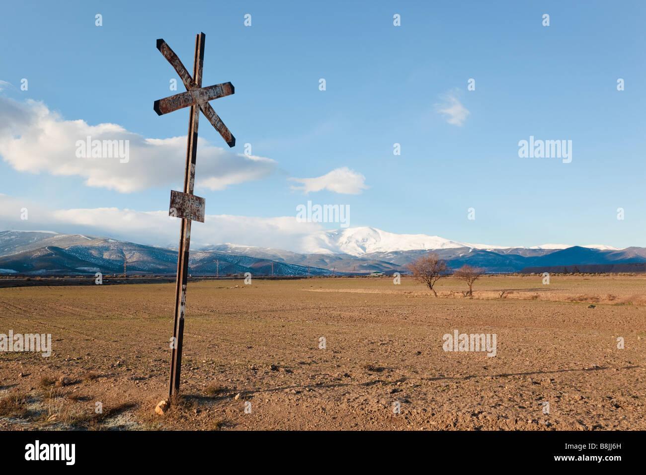 Railway crossing sign near La Calahorra Granada Province Spain Sierra Nevada in background - Stock Image