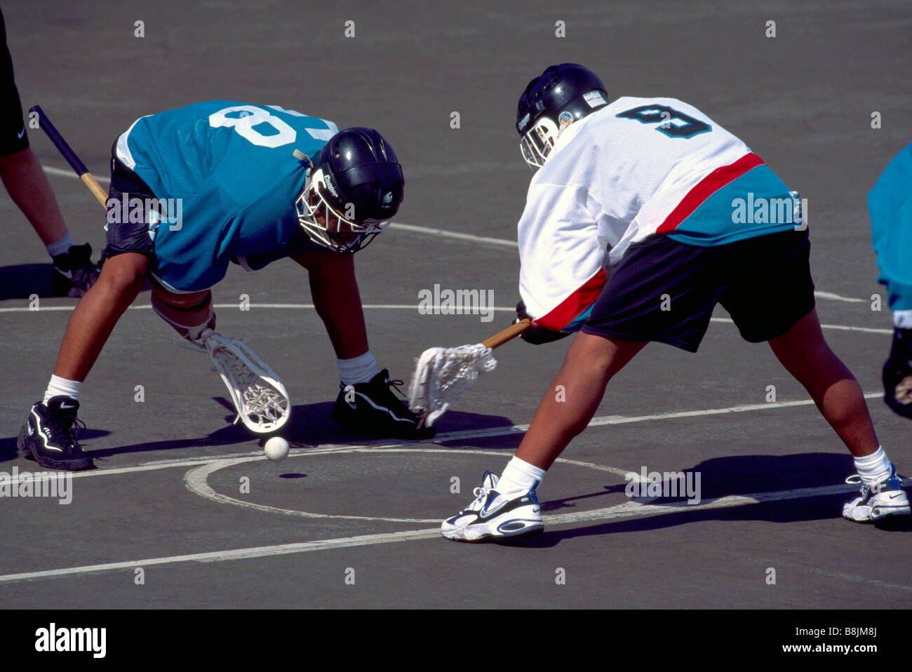 Native American Indians facing off in a Game of Lacrosse - Stock Image