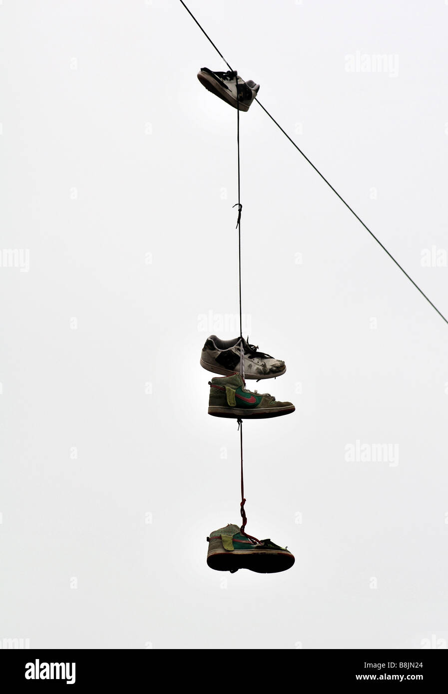 Shoes hanging from telephone wire, UK Stock Photo: 22539276 - Alamy