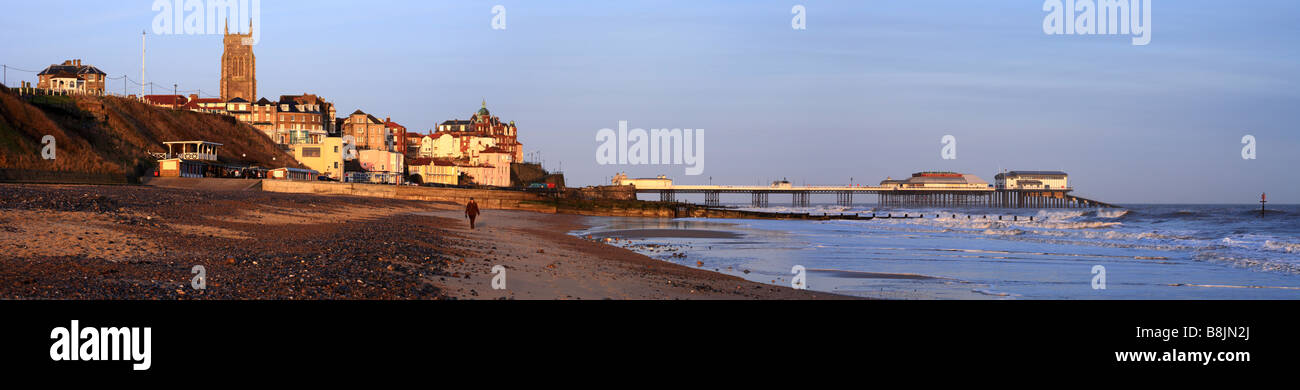 'Cromer' pan, town, beach and pier with a single person walking on the beach. Cromer, Norfolk, East Anglia, - Stock Image
