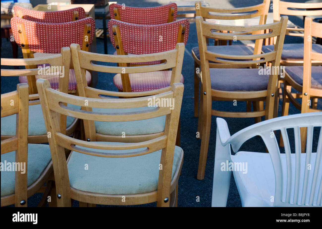 Secondhand chairs are displayed for sale at THE VILLAGE MARKET in Greenwich, London England UK - Stock Image