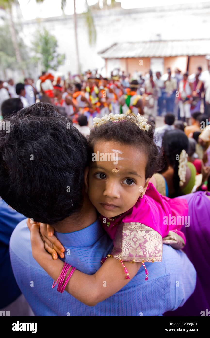 India Tamil Nadu Madurai Thiruchuli village young child in fathers arms Stock Photo