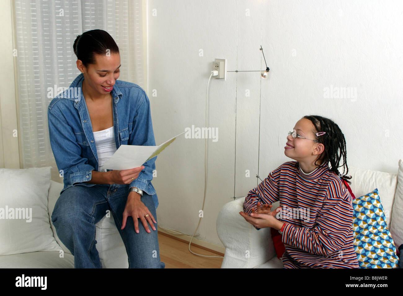 Happy mother reading report card. SerieCVS117007 - Stock Image