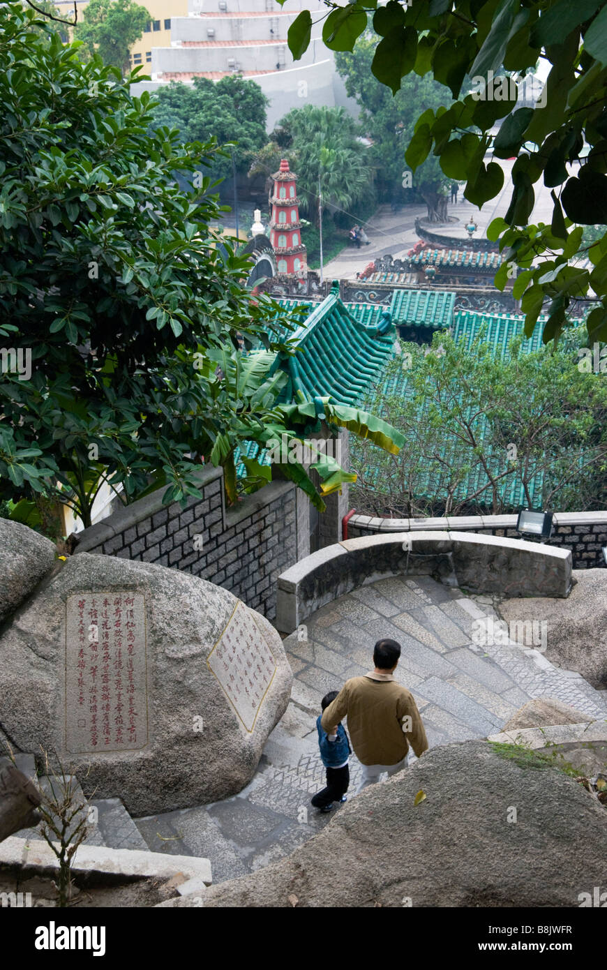 Father and son descending steps at A-Ma Temple, Macau Stock Photo