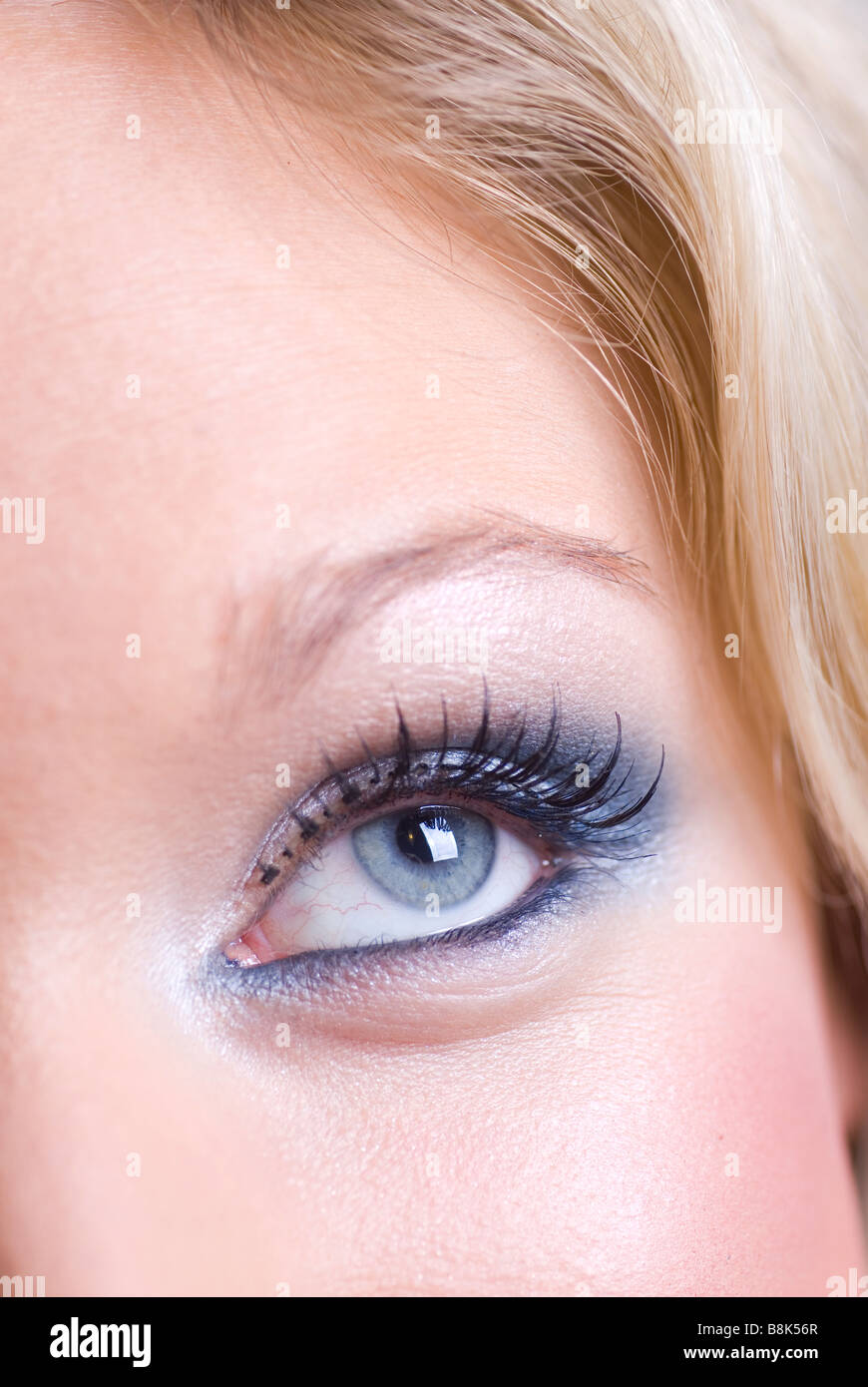 Close up of a beautiful young blond woman looking up Stock Photo