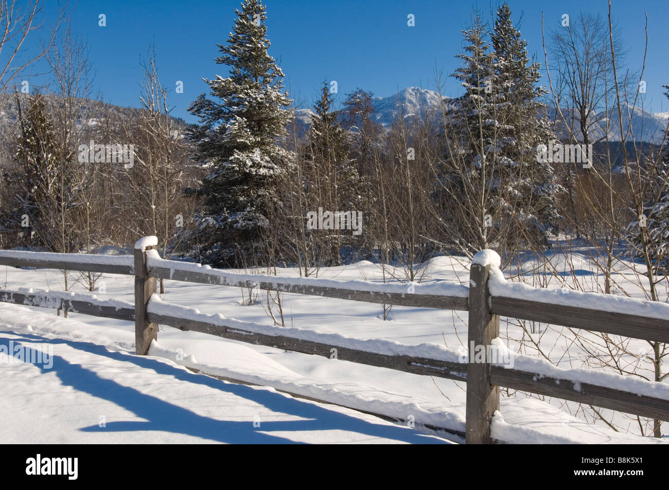 Old farm fence in a snowy field.  Pemberton BC Canada - Stock Image