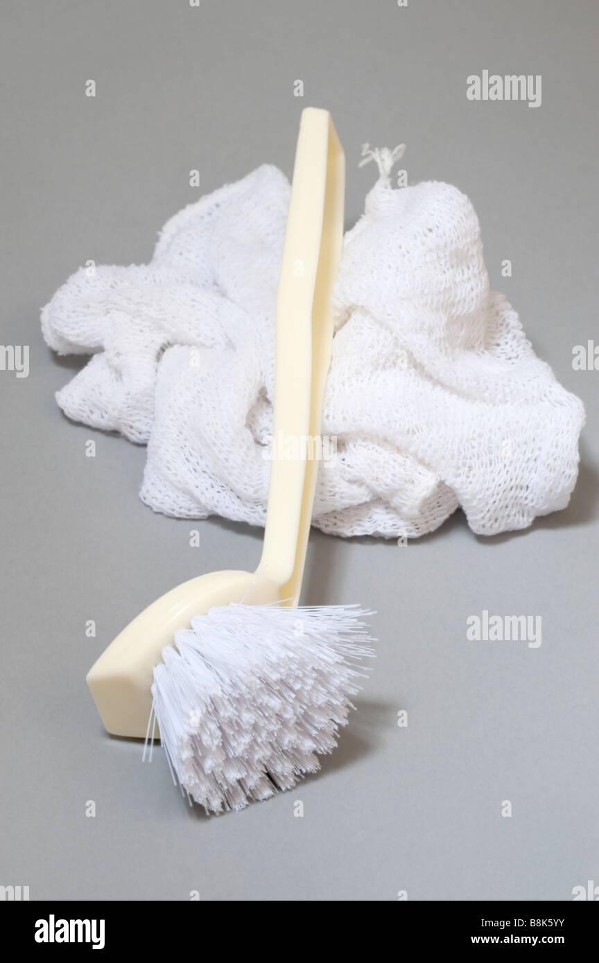 Dishcloth and brush - Stock Image
