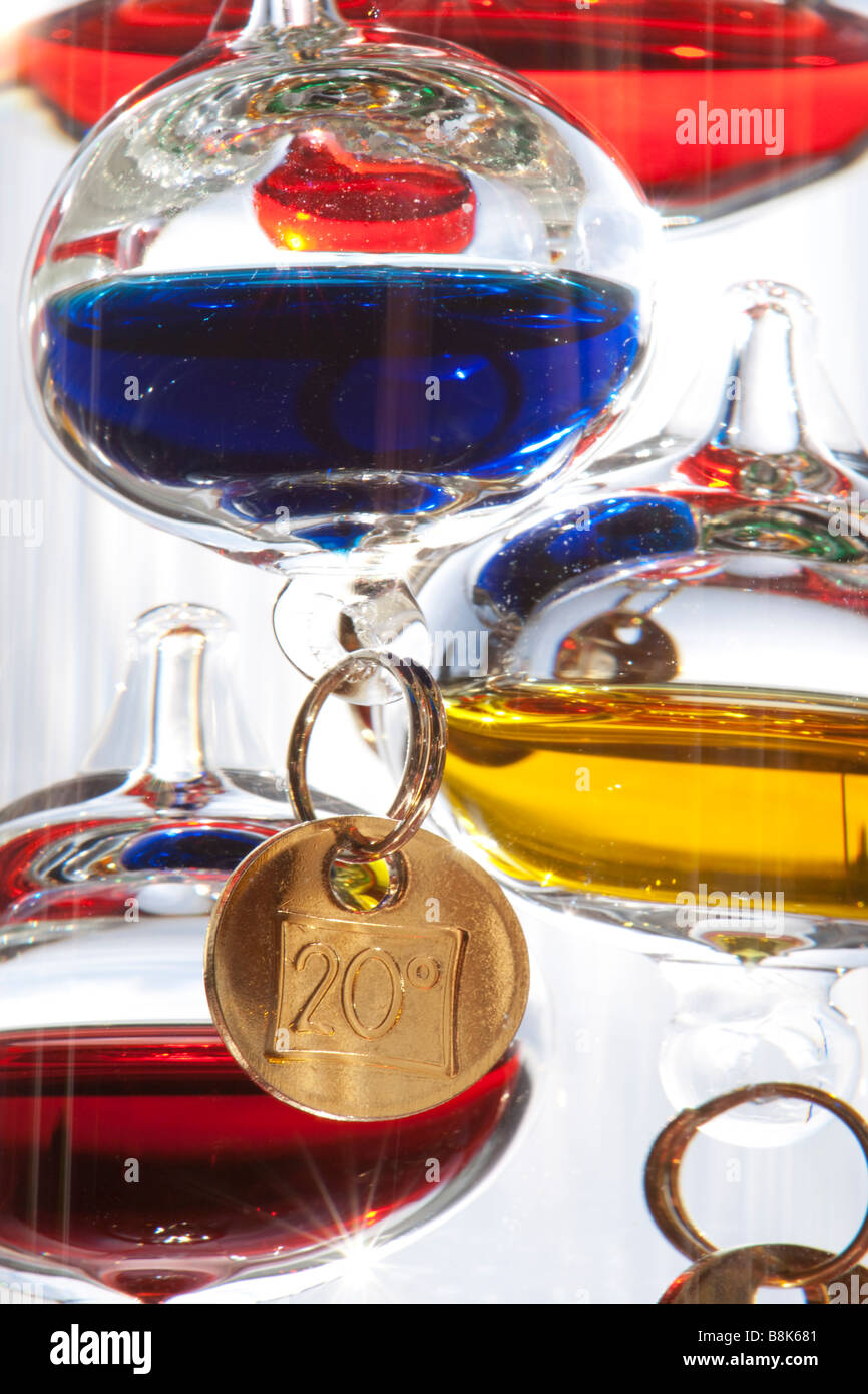 Detail of a Galileo thermometer. Tag shows twenty degrees centigrade - Stock Image