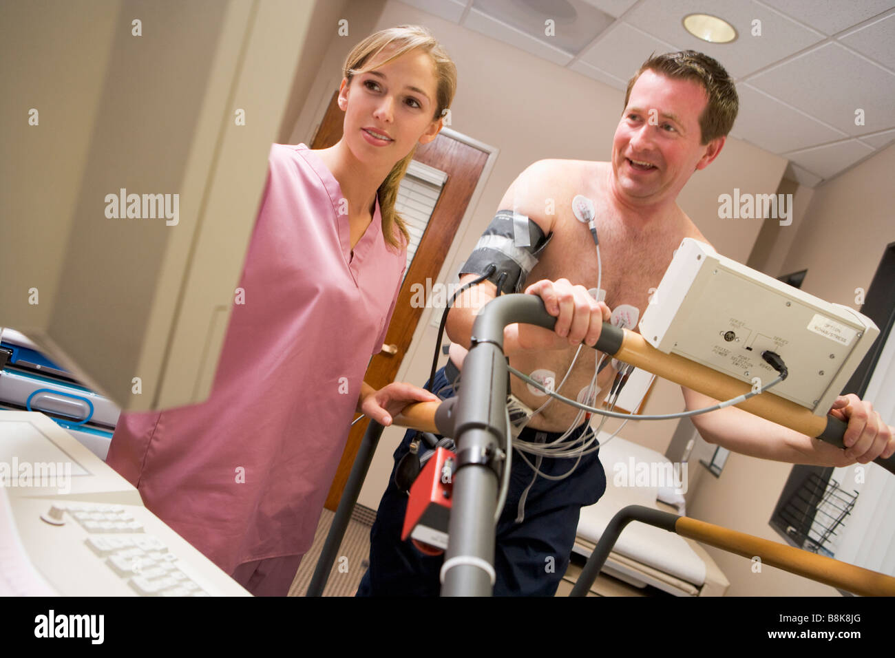 Nurse With Patient During Health Check - Stock Image