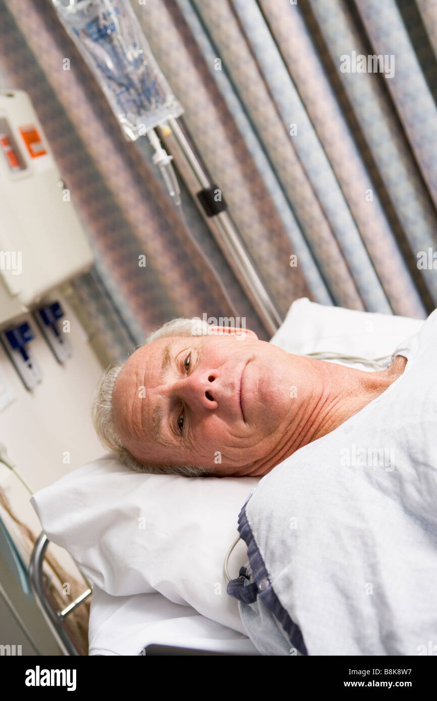 Patient In Hospital Bed - Stock Image