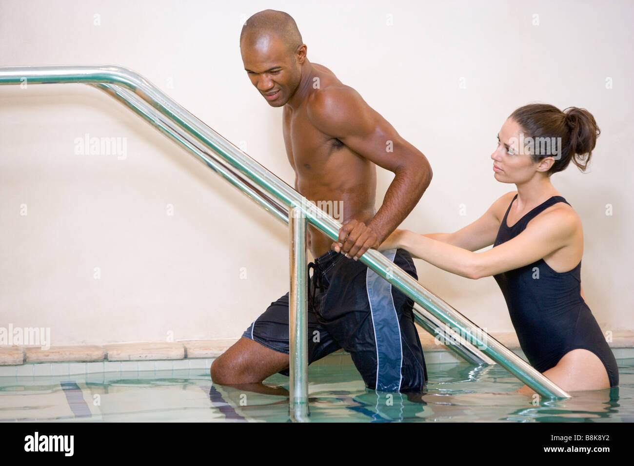 Instructor And Patient Undergoing Water Therapy - Stock Image