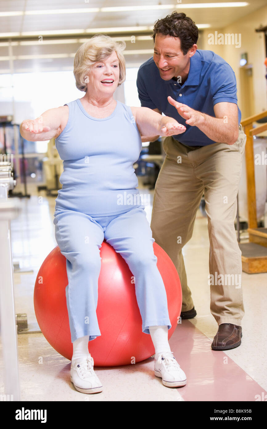 Physiotherapist With Patient In Rehabilitation - Stock Image