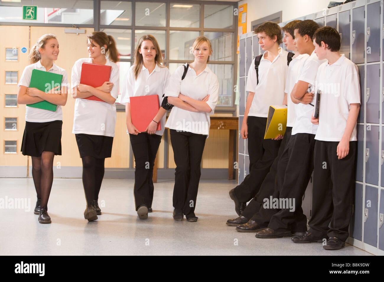 Secondary school students in a school hallway Stock Photo