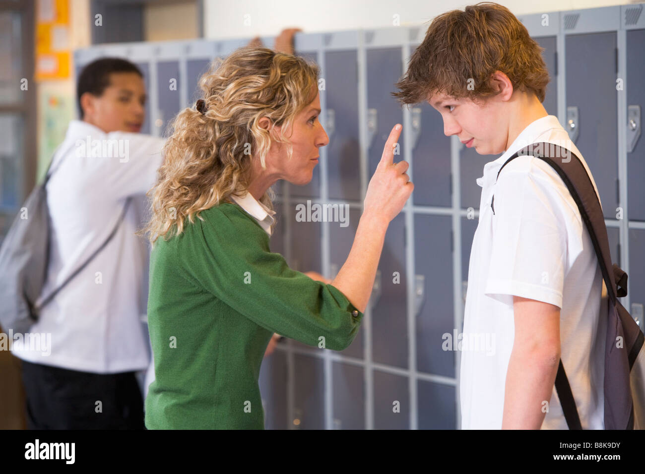 NOLA: Female teacher and male students