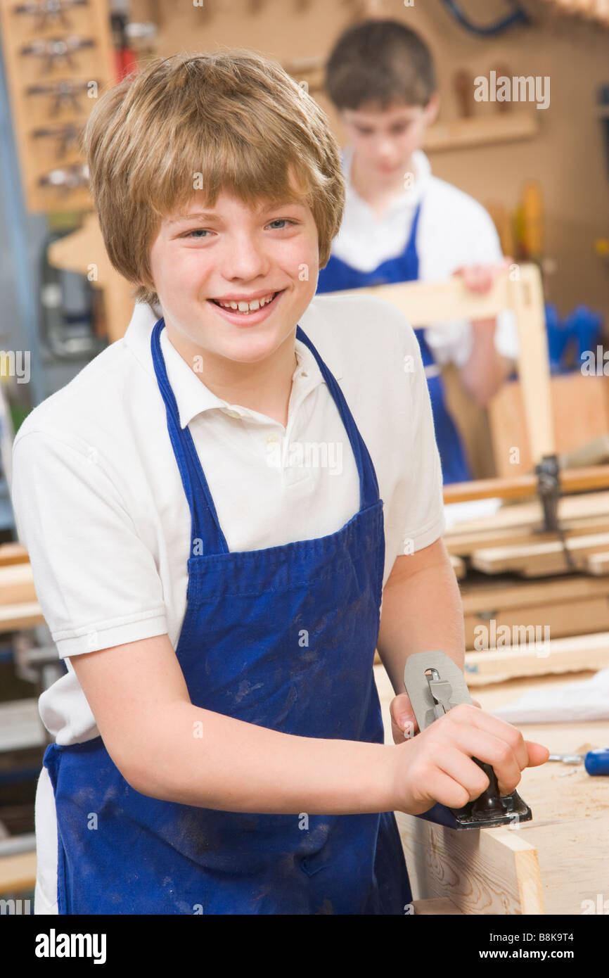 Male student learning woodworking - Stock Image