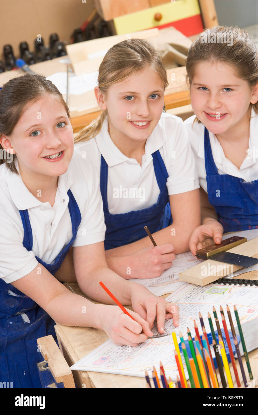 Female students learning woodworking - Stock Image
