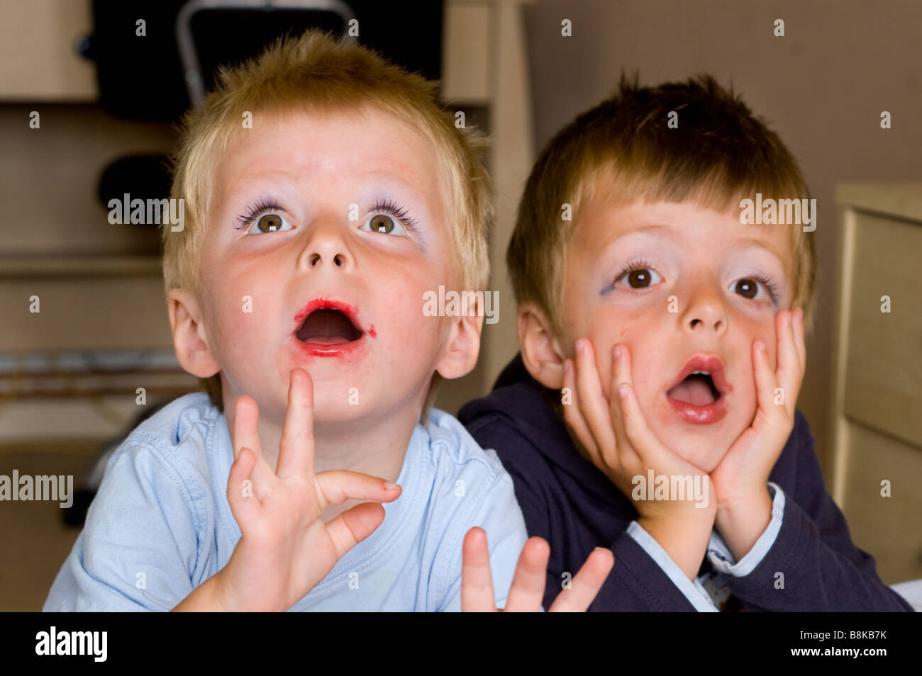 Two Little Boys Wearing Their Mothers Make Up With Humourous Stock