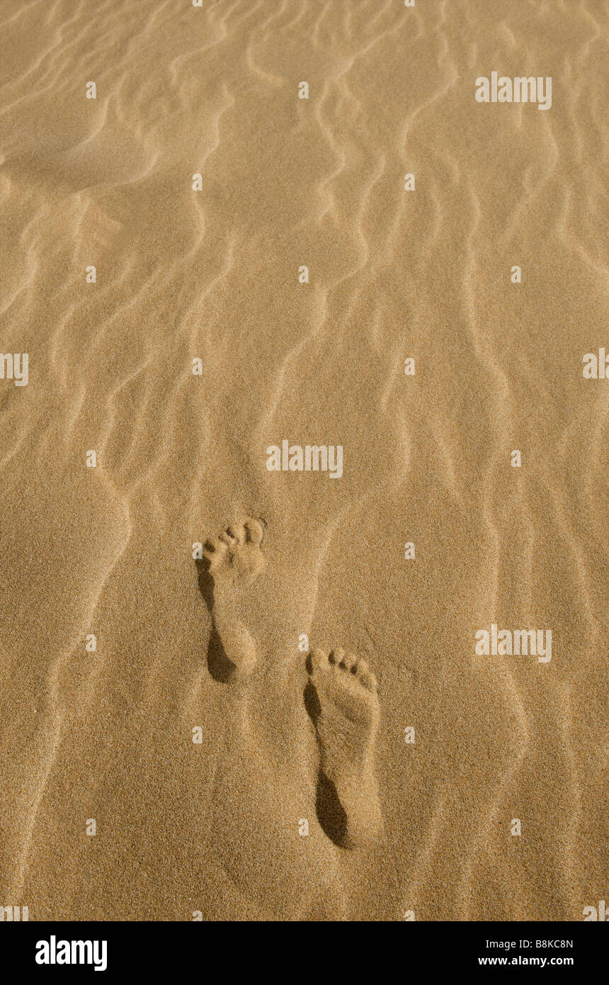 Right and left foot human prints in the sand from above at Australian beach - Stock Image