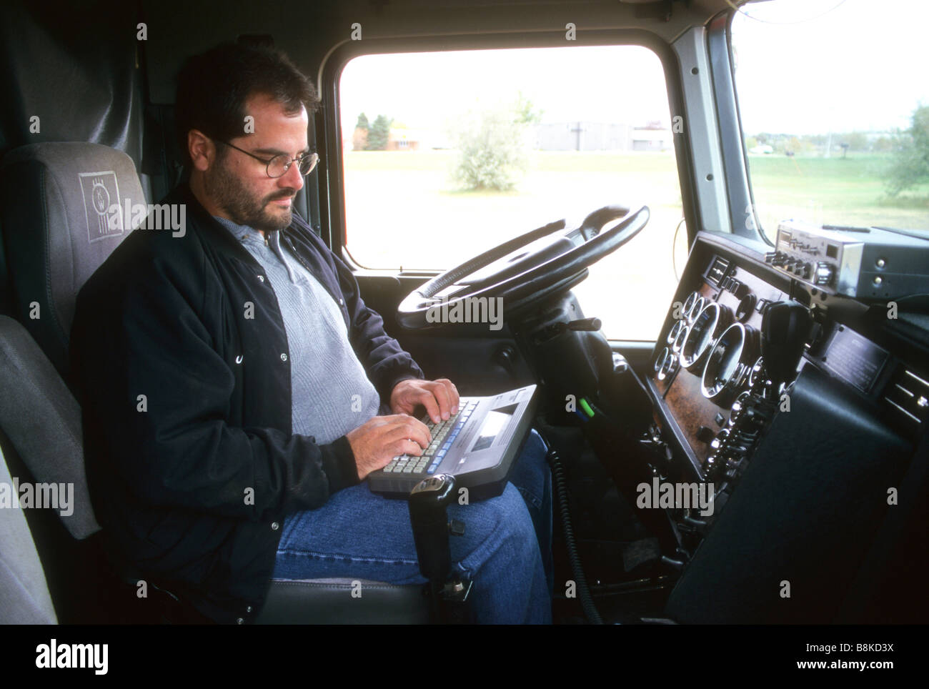 truck driver computer steer wheel cab plan route track safe safety modern communication contact speed fuel cargo Stock Photo