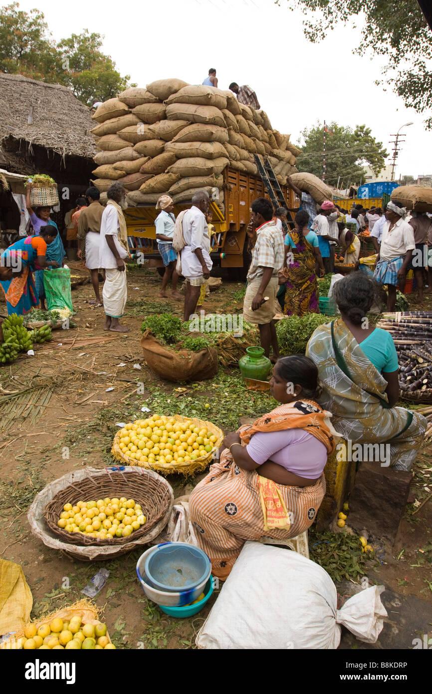 India Tamil Nadu Madurai North Avani Street market unloading lorry load of sacks - Stock Image