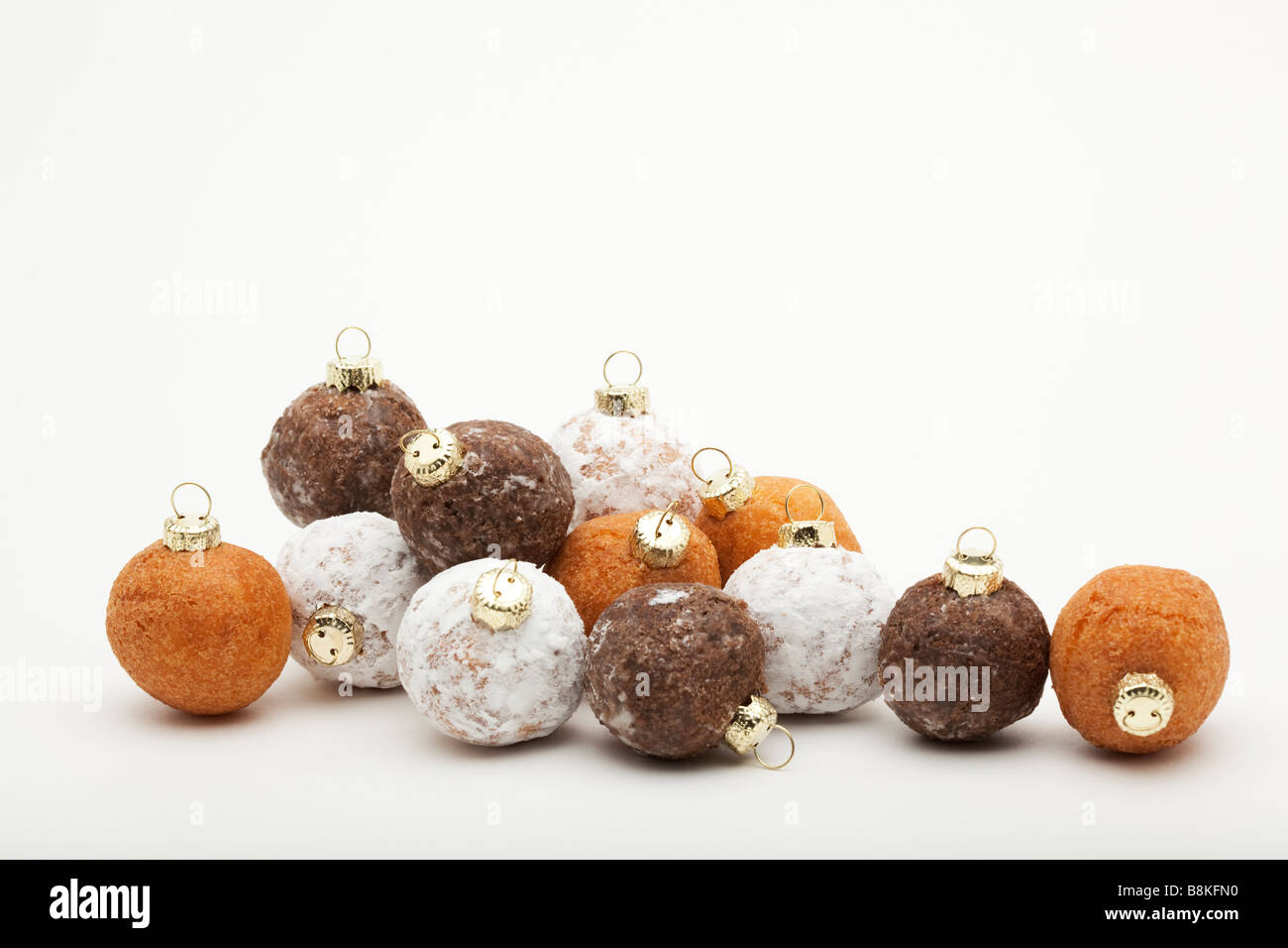 Christmas Ornament Tops.Twelve Donut Holes With Christmas Ornament Tops Stock Photo