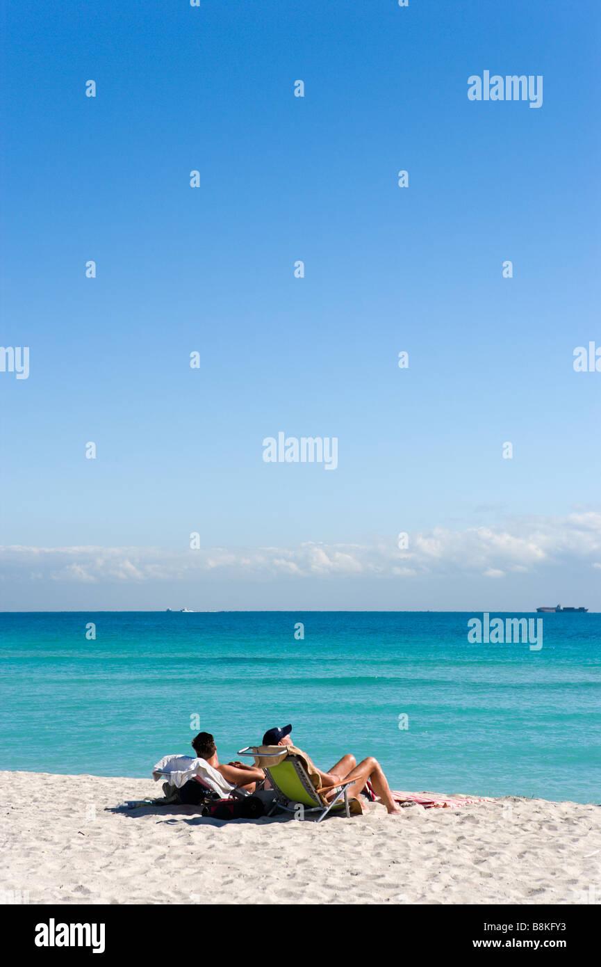 Two Men Sunbathing On South Beach, Miami Beach, Gold Coast