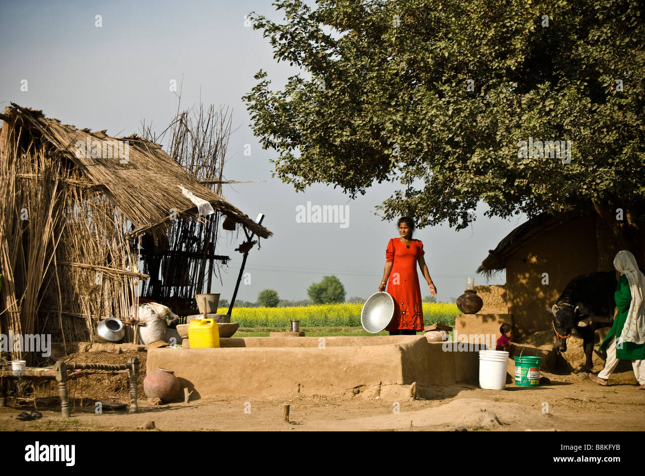 Some cheery women attending to their daily routine in the colourful 'Dolori' village, 300km from Jaipur, India. Stock Photo