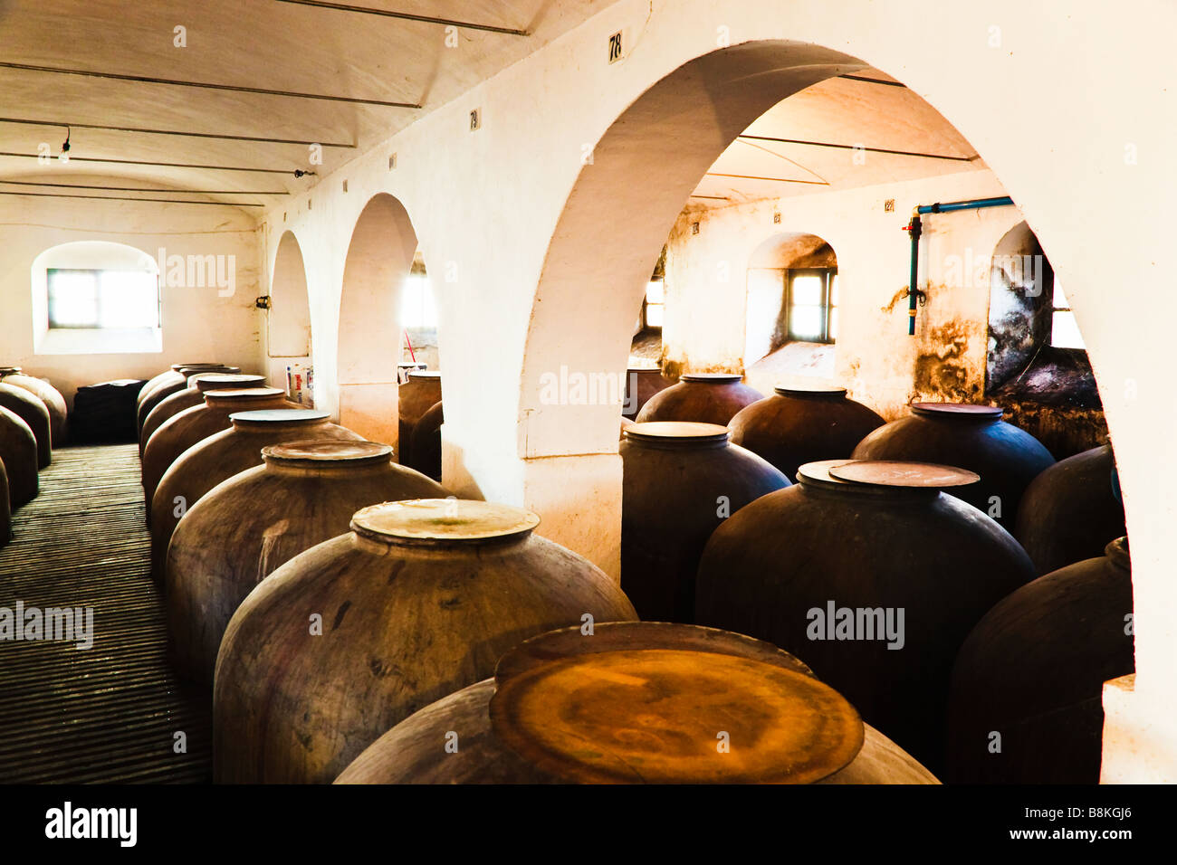 Montilla Cordoba Province Spain Interior Bodegas Navarro showing tinajas or earthenware jars in which wine ferments - Stock Image