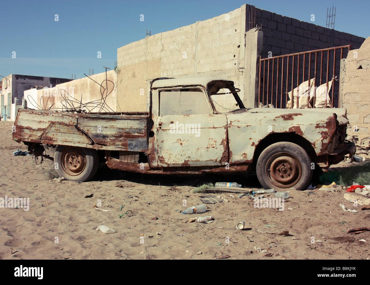 Battered Peaugot pickup truck in Nouadhibou Mauritania Western Sahara - Stock Image