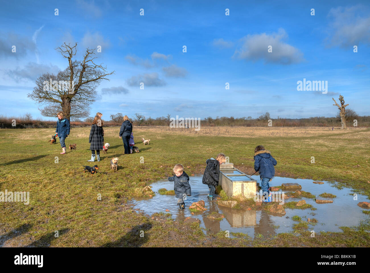 Group of children playing in mud and water Stock Photo