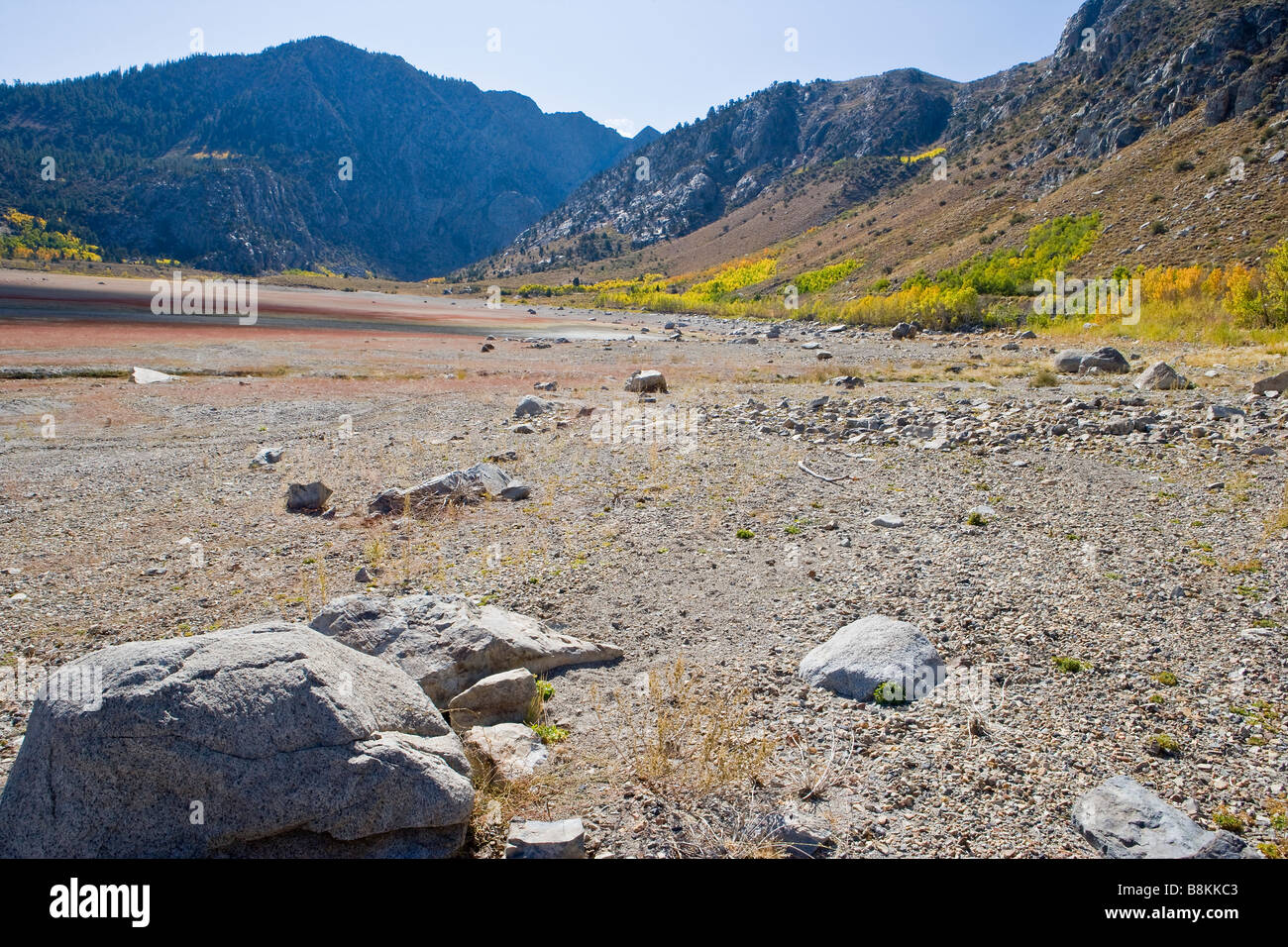 Grant Lake nearly empty due to drought June Lake Loop Sierra Nevada Mountains California United States of America - Stock Image