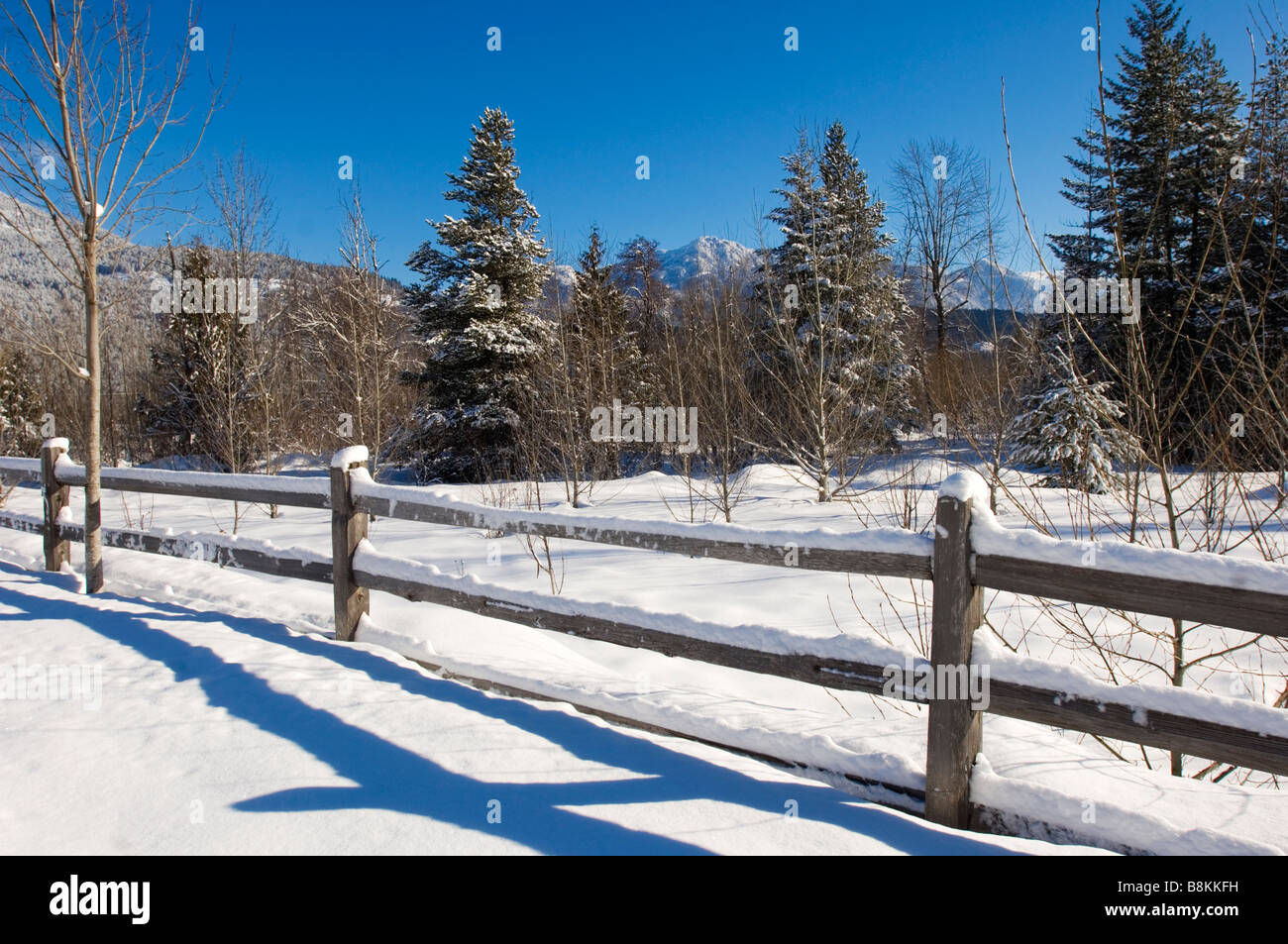 Old farm fence in a snowy field Pemberton and Whistler BC, Canada - Stock Image