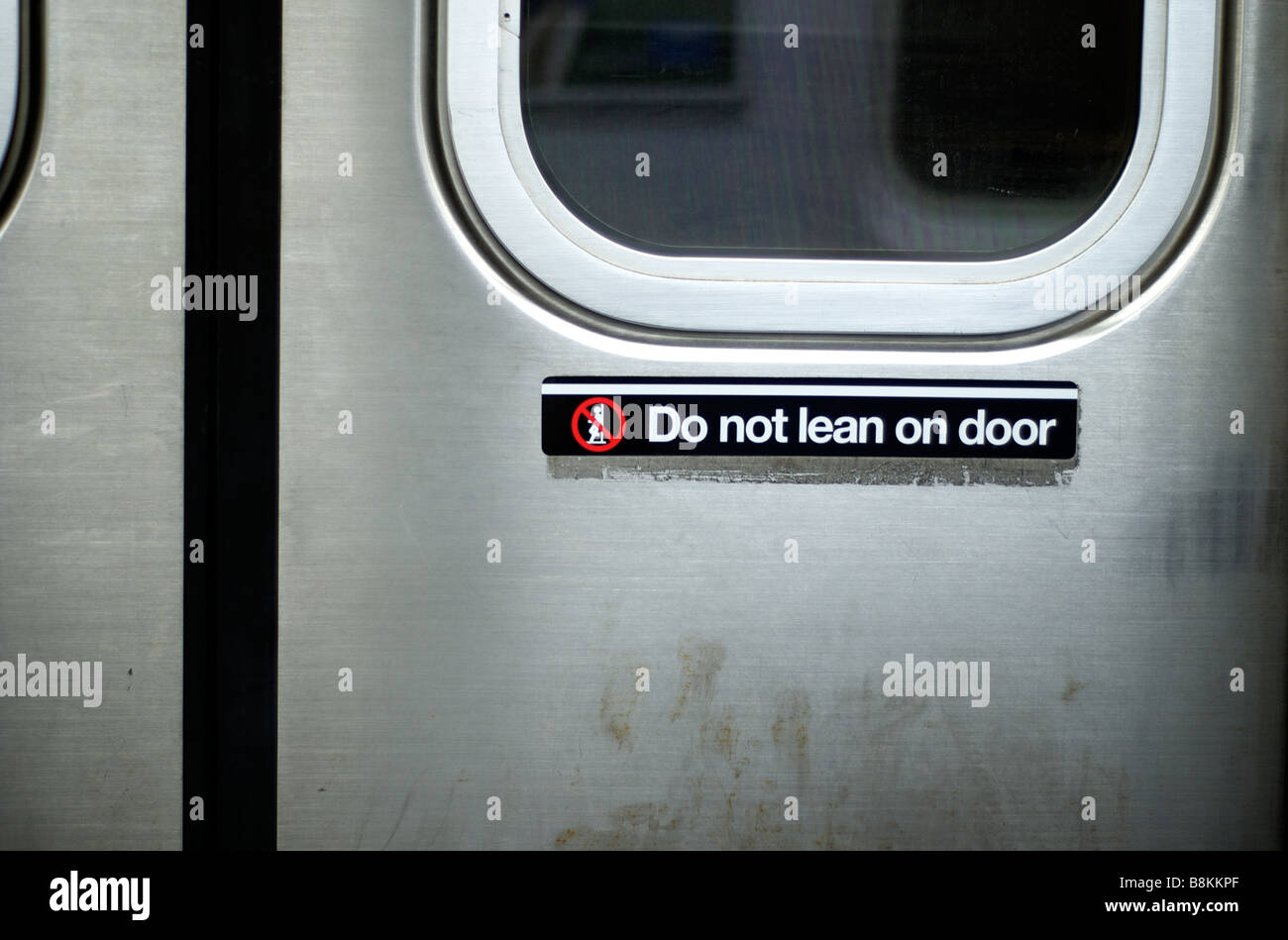 Detail of Dirty New York City Subway Door with sign \ Do Not Lean On Door & Detail of Dirty New York City Subway Door with sign \