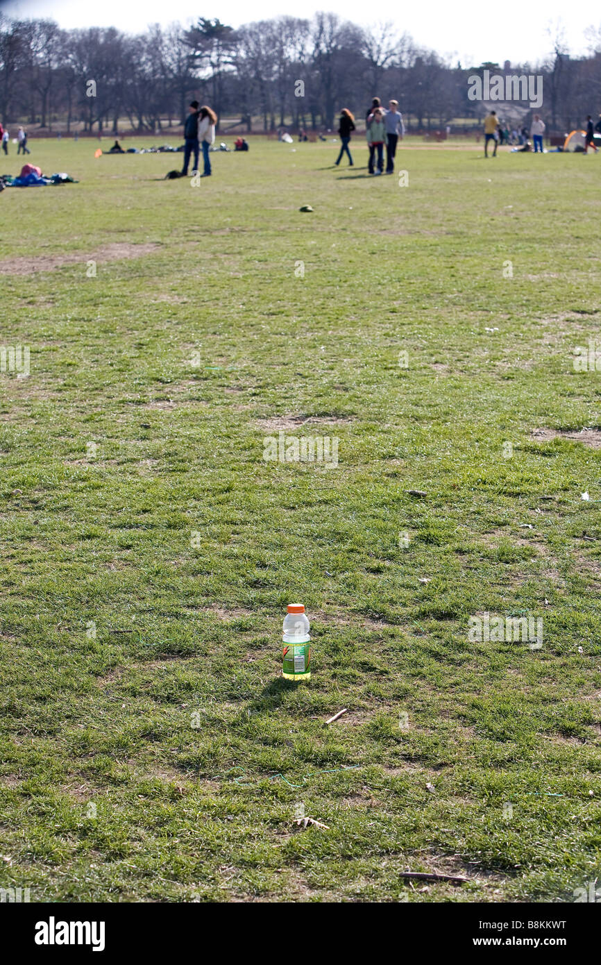 A sports drink bottle on the playing field - Stock Image