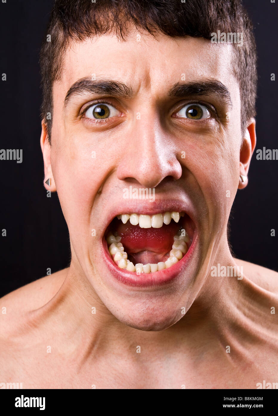 Scream of shocked and scared young man Stock Photo