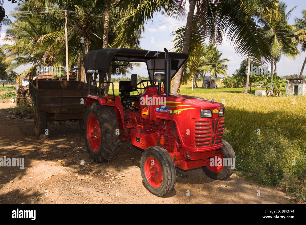 India Tamil Nadu Madurai Tidiyan Mahindra tractor parked in small rural  farming village - Stock Image
