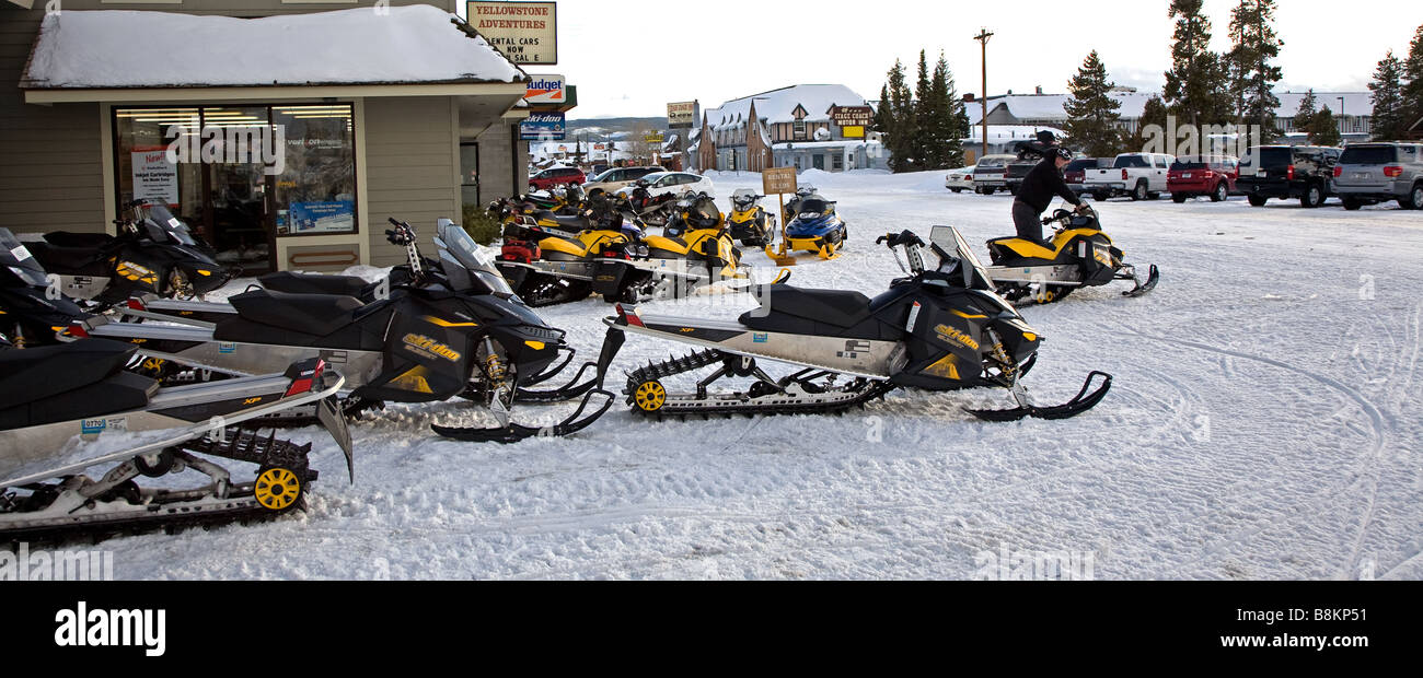 Snowmobiles parked in West Yellowstone, USA - Stock Image