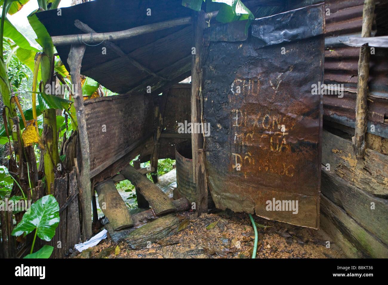 village toilet in vietnam - Stock Image