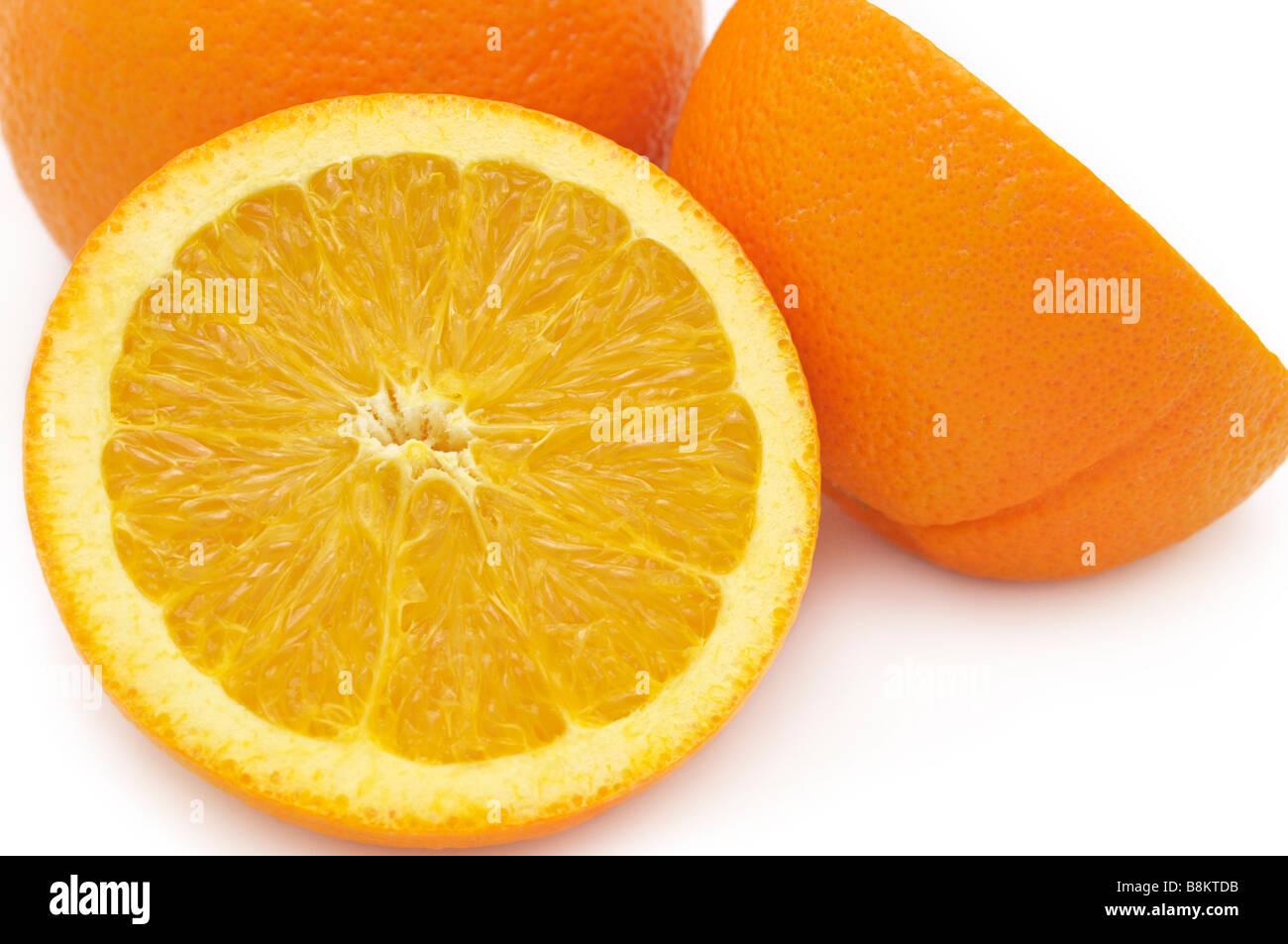 Oranges closeup, Whole and Half - Stock Image