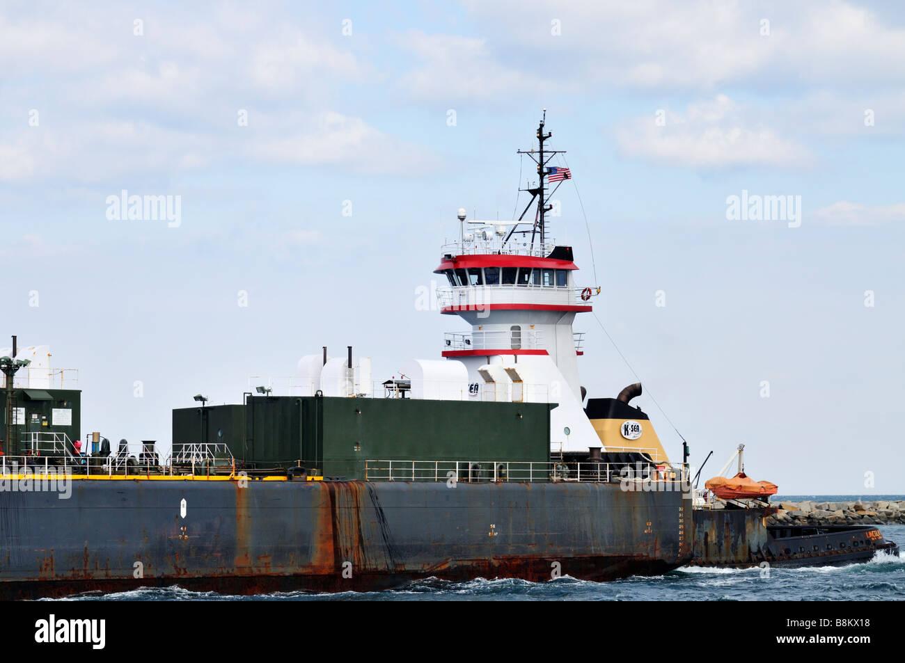 Side profile of a Tugboat pushing