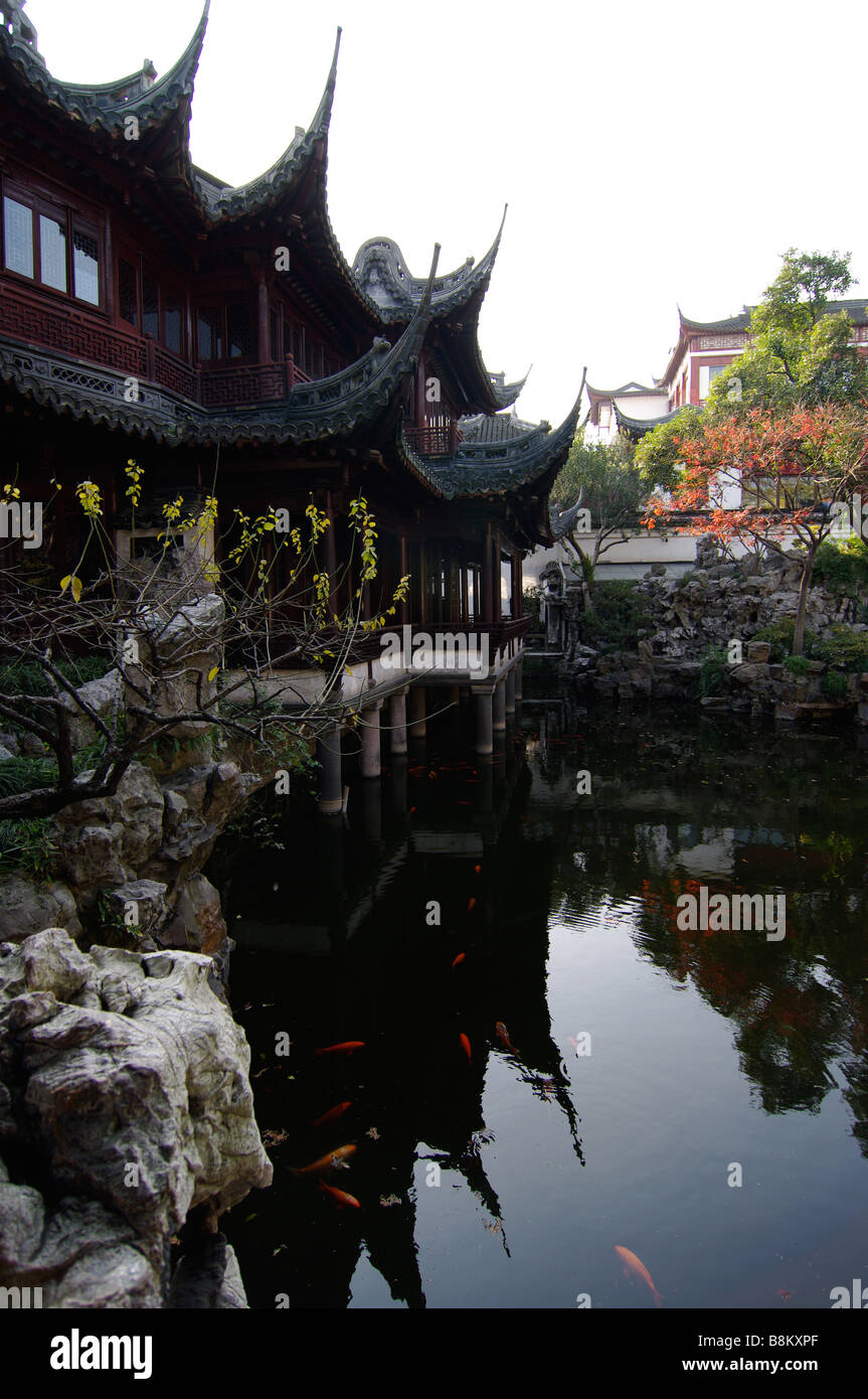 A Chinese Koi pond reflects the ancient architecture of China Stock