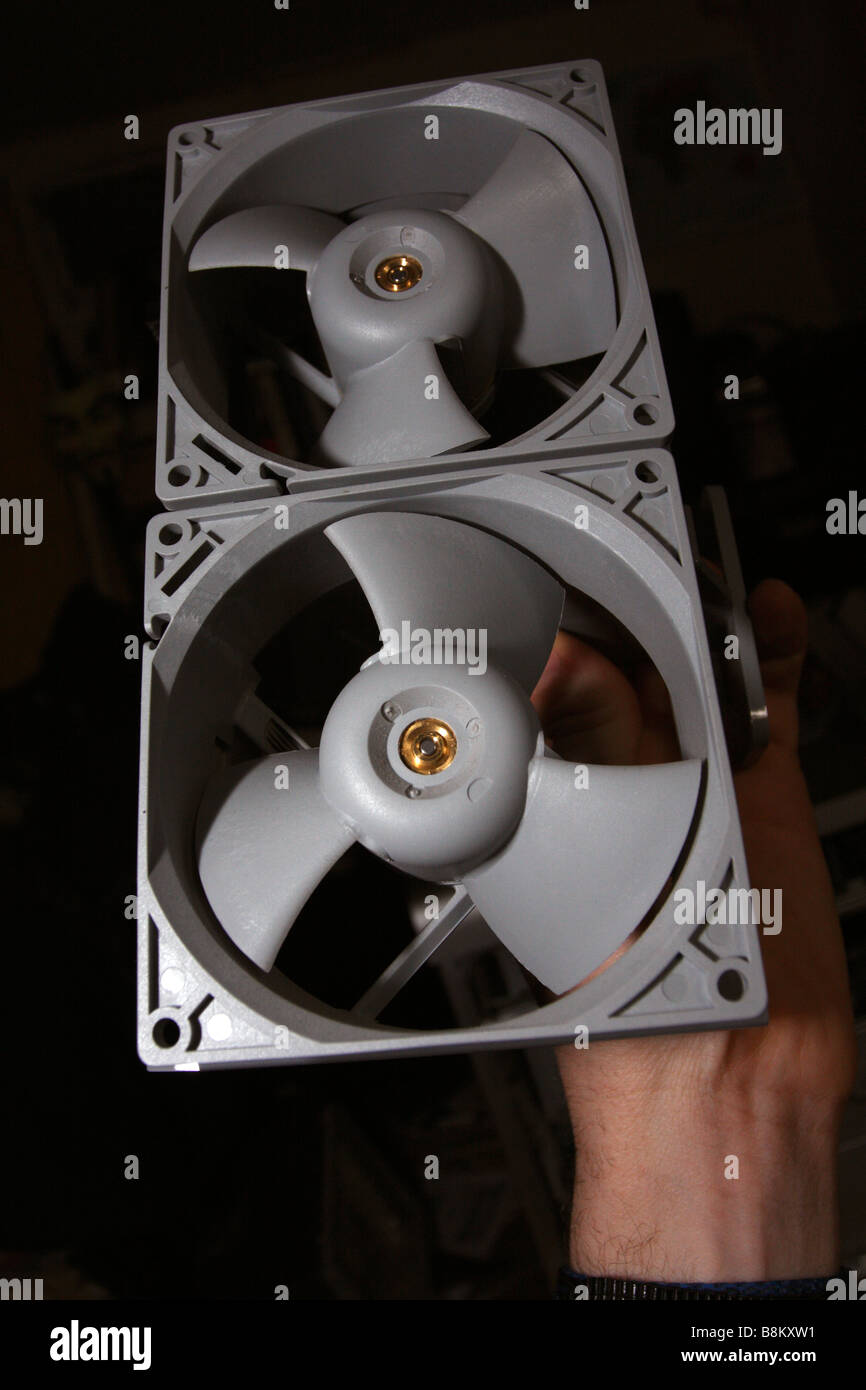 One of the dual plastic fan assemblies from an Apple PowerMac G5 - Stock Image