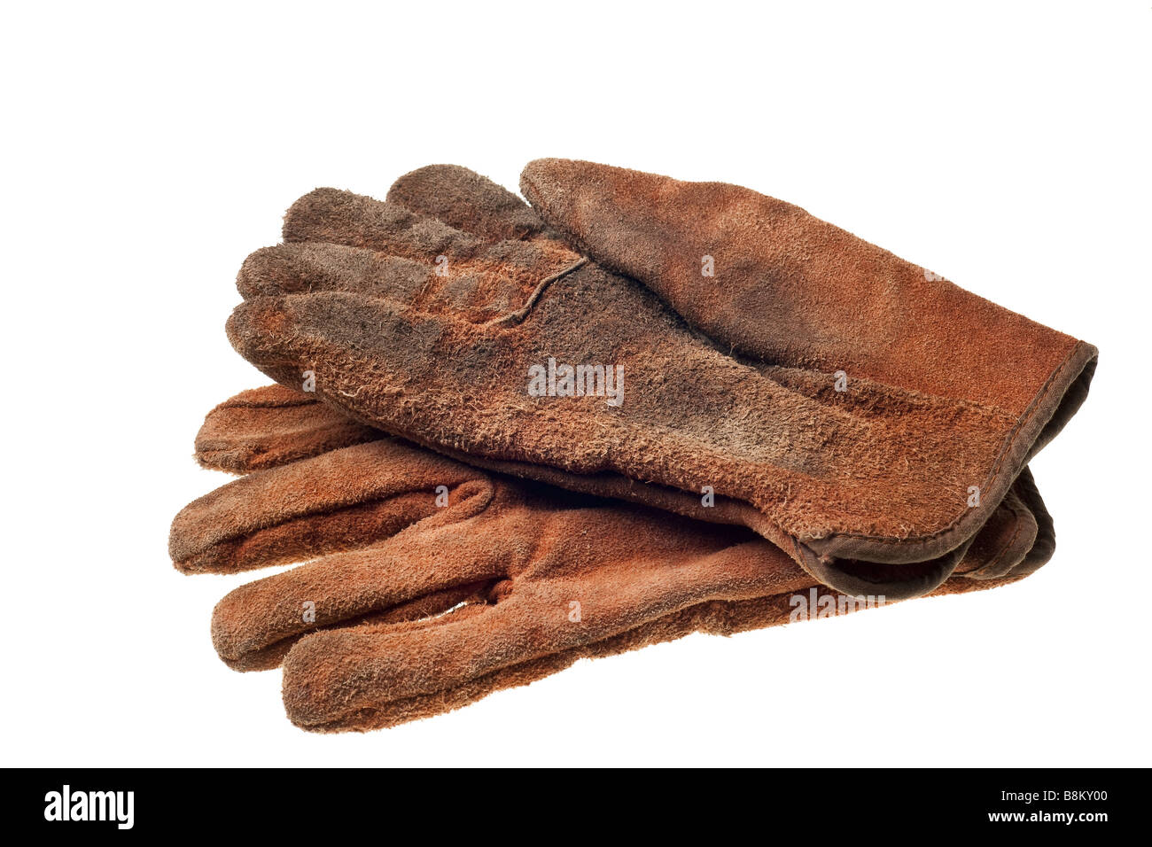 old grungy work gloves isolated on white background - Stock Image