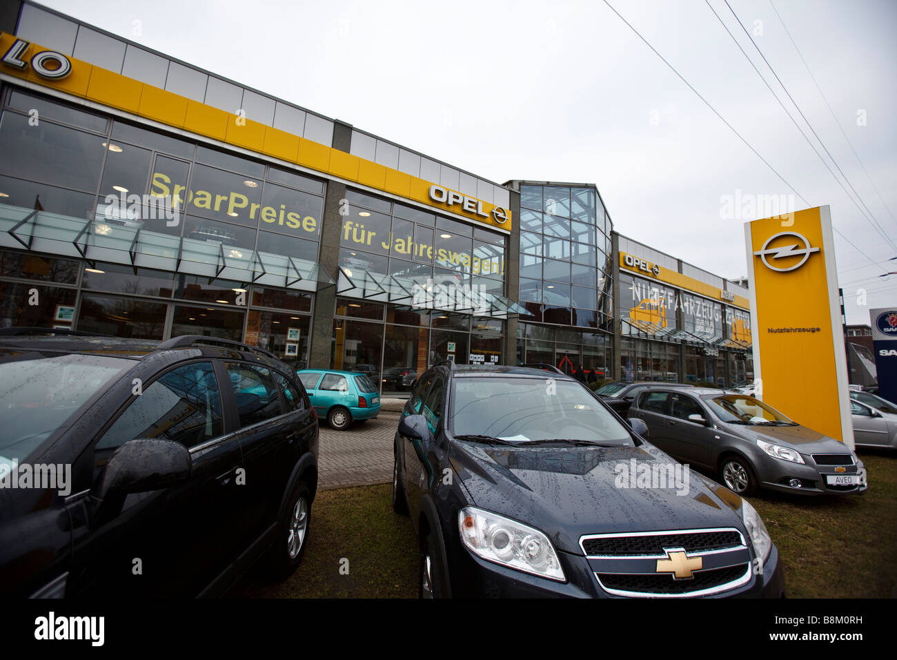 Chevrolet and Opel cars for sale at an car dealership in Hamburg, Germany - Stock Image