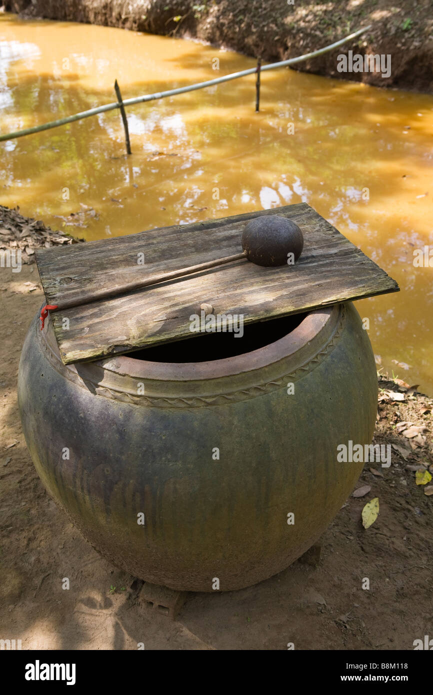 water pot by river - Stock Image